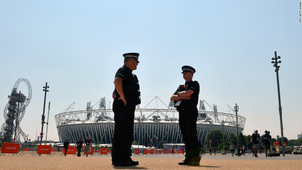 Security personnel patrol in front of Olympic Park in London on Thursday, a day ahead of the opening ceremony.  Security concerns surfaced when a private contractor failed to provide enough staff. As a result, the government is deploying 18,200 troops to remedy the shortfall.