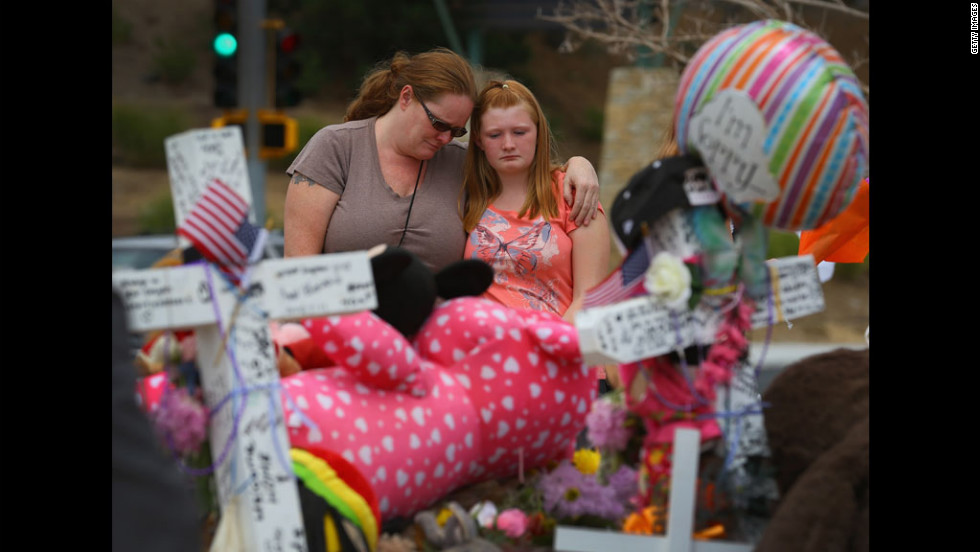 Carrie Hensley, left, and Hailee Hensley mourn together on Wednesday.