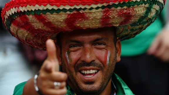 A Mexican fan watches the men