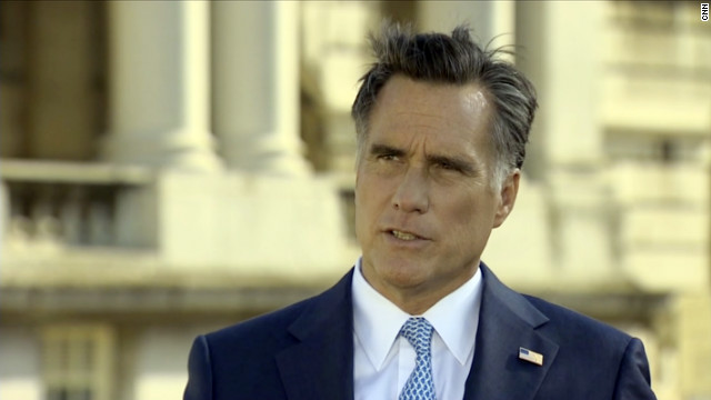 Mitt Romney defends his business career in a CNN interview from London on Thursday.