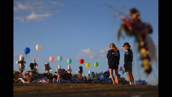 People visit a memorial across the street from the Century 16 movie theater on Thursday, July 26, in Aurora, Colorado.