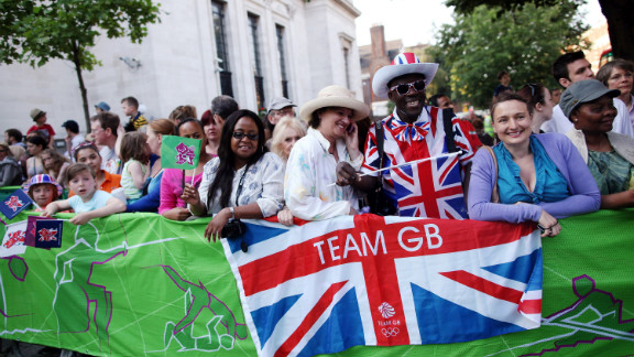 Spectators gather as the Olympic torch is carried from Islington Town Hall on Thursday. London cheered on the torch as it made its way past the city