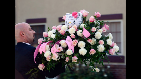 Hello Kitty-themed flowers are sent to shooting victim Micayla Medek's funeral Thursday in Denver.