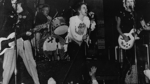"""Infamous British punk rock group The Sex Pistols playing live in Copenhagen in 1977. Though banned by the BBC during their time as an act, their song """"Pretty Vacant"""" was included in the Danny Boyle-directed Olympic opening ceremony."""