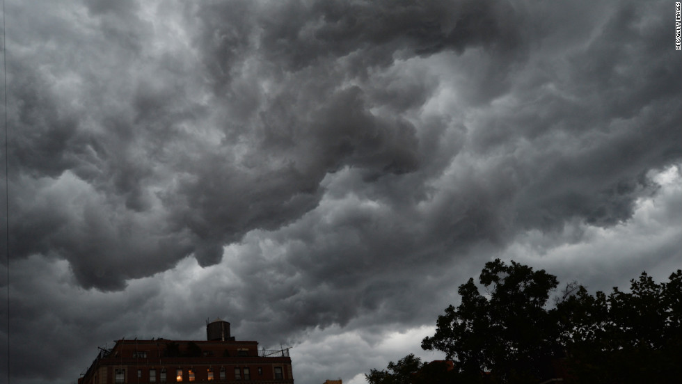 Clouds gather over apartment buildings ahead of a thunderstorm on the east side of Manhattan on Thursday.