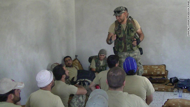 Libyan revolution veteran Al-Mahdi al-Harati (standing) training members of the Liwa al-Umma to fight in Syria.