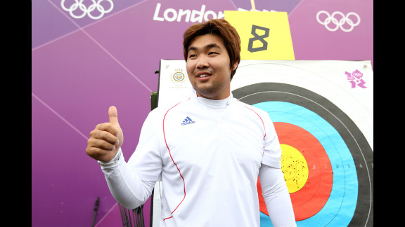 South Korean archer Im Dong Hyun celebrates breaking the first world record of the London Olympics on Friday. The two-time gold medalist, who is classified as legally blind and can