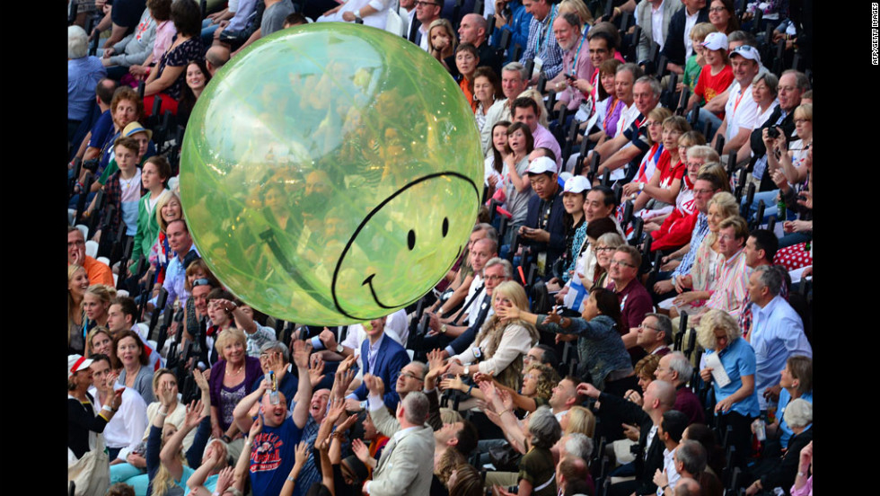 A balloon flies over spectators prior to the opening ceremony.