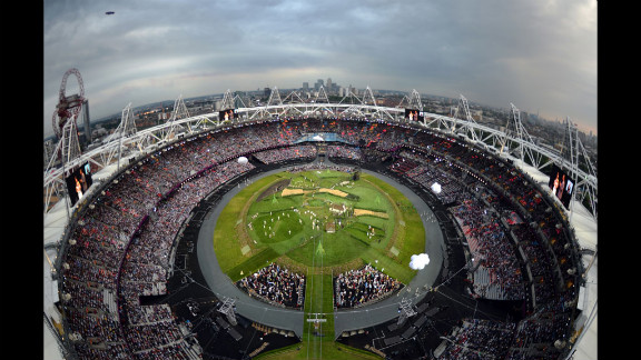 A robotic camera captures an overview of the Olympic Stadium at the start of the London 2012 Opening Ceremony.