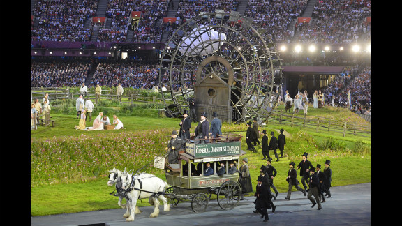 Artists arrive in a horse and carriage.