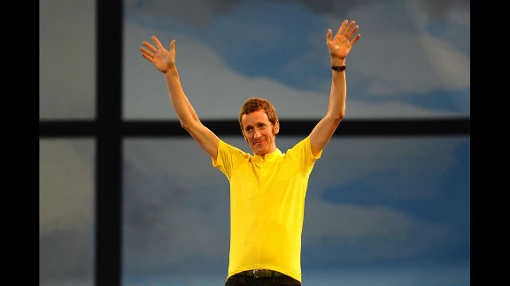 Bradley Wiggins, the first British winner of the Tour De France cycle race, waves to the audience.