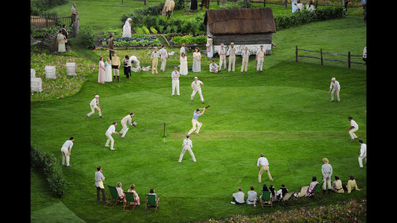 Cricketers play on the pitch during the preshow.