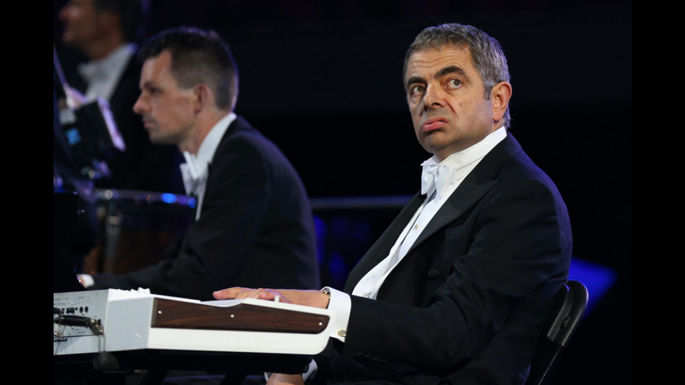 British actor Rowan Atkinson in his role as Mr. Bean plays in the orchestra.