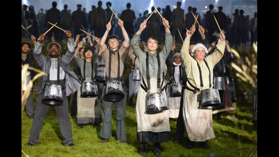 Actors perform during the British meadow scene during the opening ceremony.