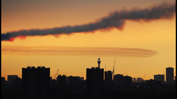 The Red Arrows disappear over London ahead of the opening ceremony.