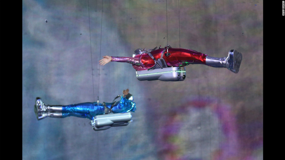 Performers with jetpacks take part in the opening ceremony.