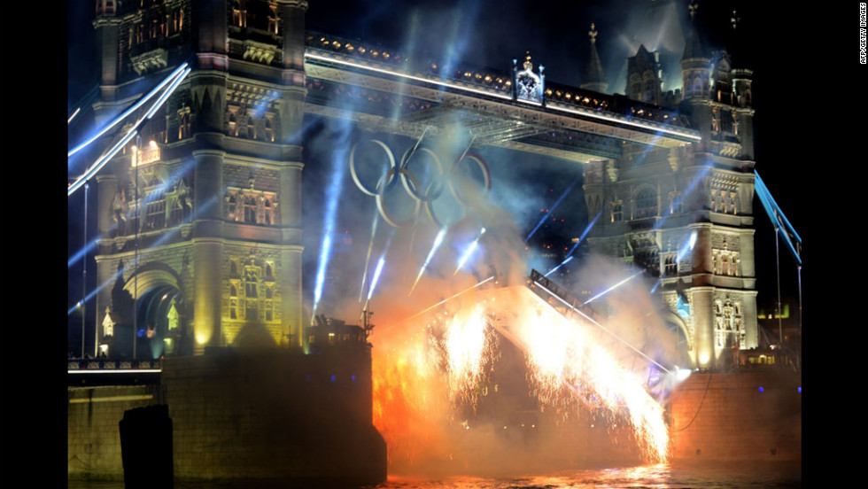 Fireworks go off from Tower Bridge.