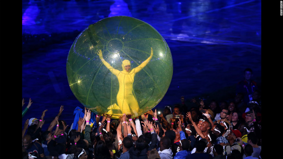 A performer in a giant ball is passed around during the opening ceremony.