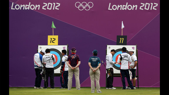 Competitors inspect targets Friday during the Archery Ranking Round at the Lord