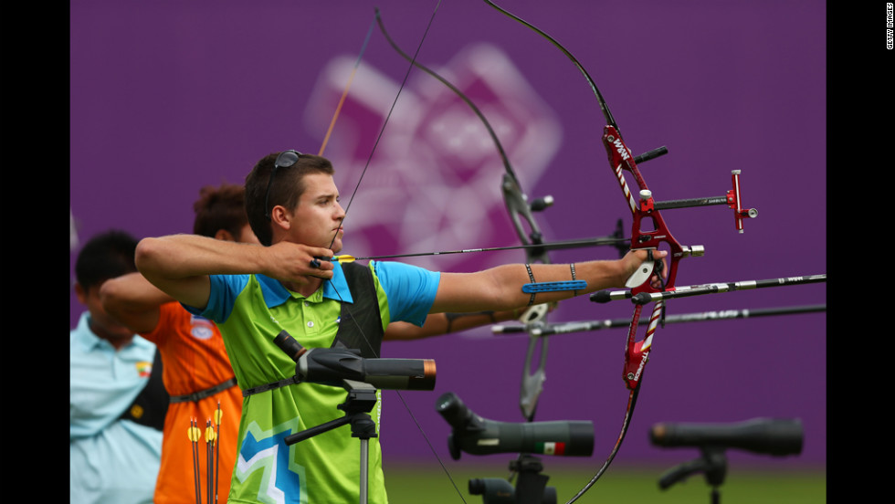 Slovenia's Klemen Strajhar gets ready to arch during the Archery Ranking Round at the Lord's Cricket Ground as part of the Olympics' opening day Friday.
