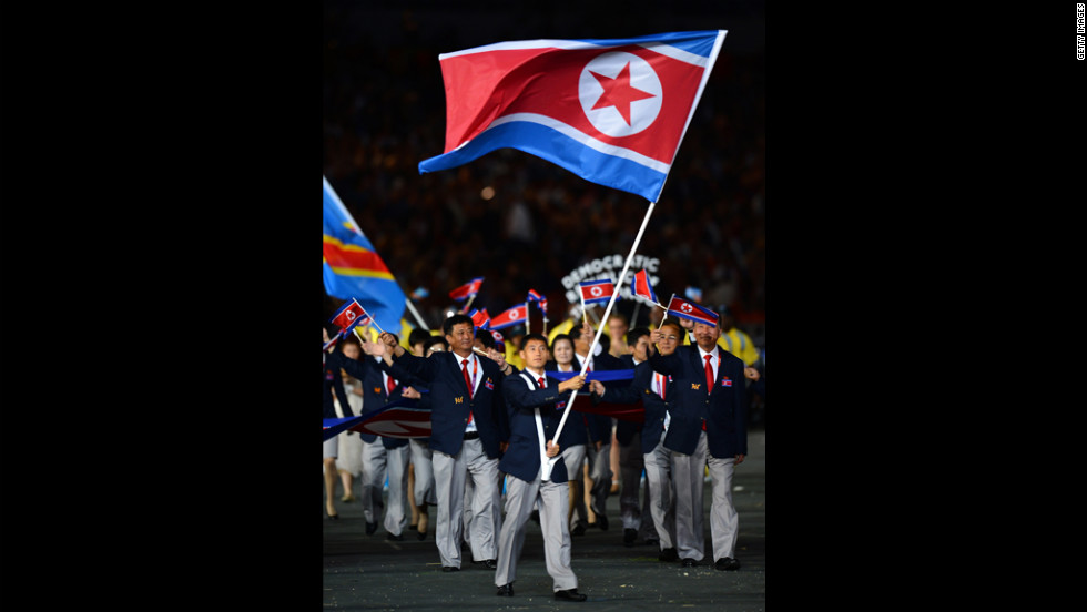 Song-Chol Pak of the North Korea Olympic team carries his country's flag.