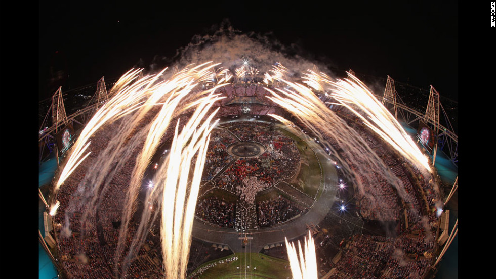 Fireworks go off over the Olympic Stadium at the official opening of the 2012 Games.