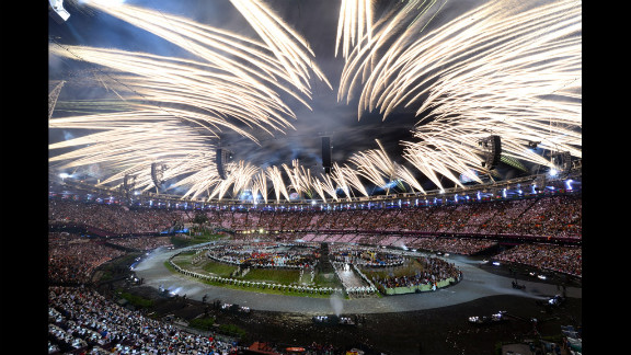 Fireworks burst above the stadium during the opening ceremony.