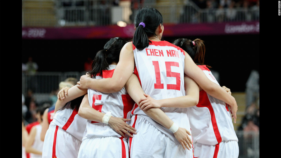 China's Nan Chen, No. 15, huddles with teammates.