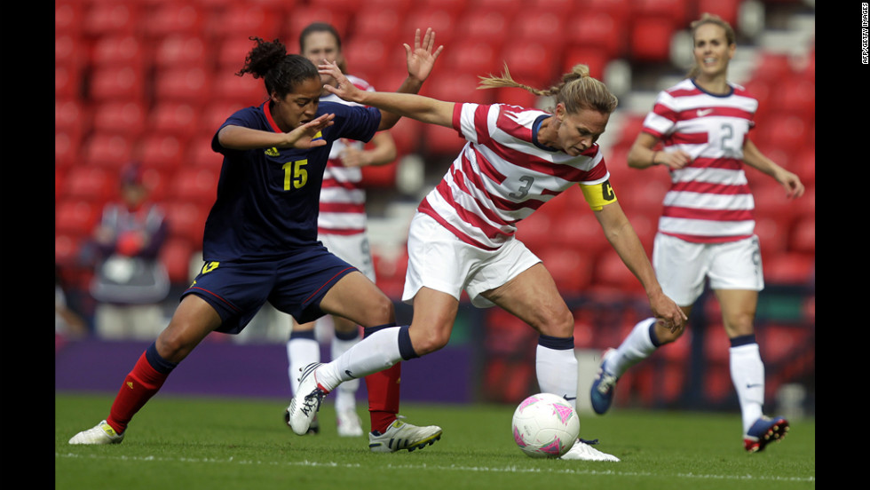 U.S. player Christie Rampone, right, vies with Colombia's Ingrid Vidal during the women's soccer competition.