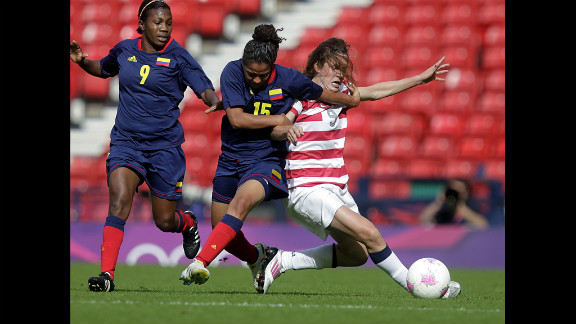 American Heather O'Reilly, right, vies with Colombia's Ingrid Vidal, second right, during a women's soccer game.