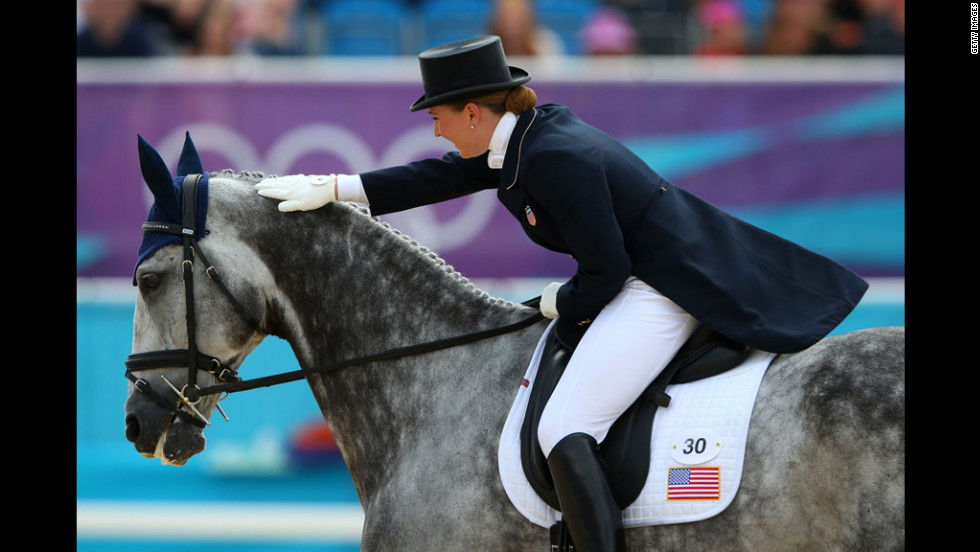 Tiana Coudray of the United States riding Ringwood Magister competes in the dressage equestrian event.