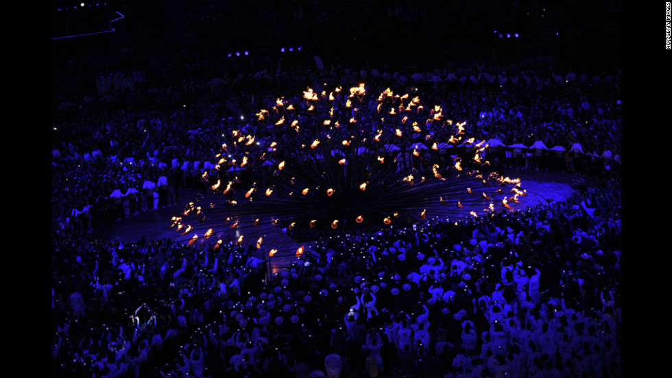 A wide view of the cauldron lighting inside the Olympic Stadium.