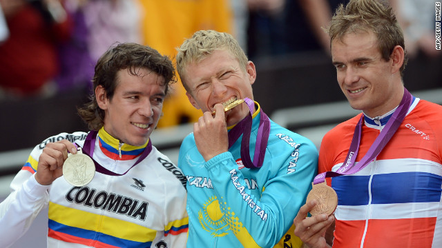 Vinokourov, centre, Uran, left, and Kristoff, right, on the podium after being presented with their medals
