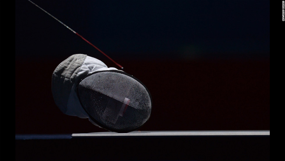 A fencing helmet lies on the field during an interruption of the women's foil fencing semifinal bout between Italy's Arianna Errigo and Italy's Valentina Vezzali.