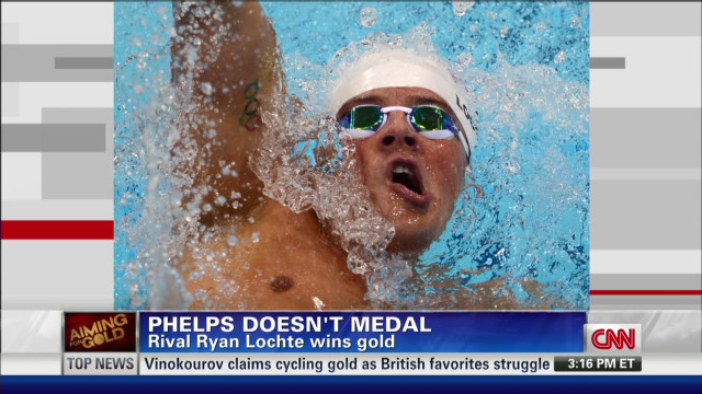 Lochte wins gold, no medal for Phelps