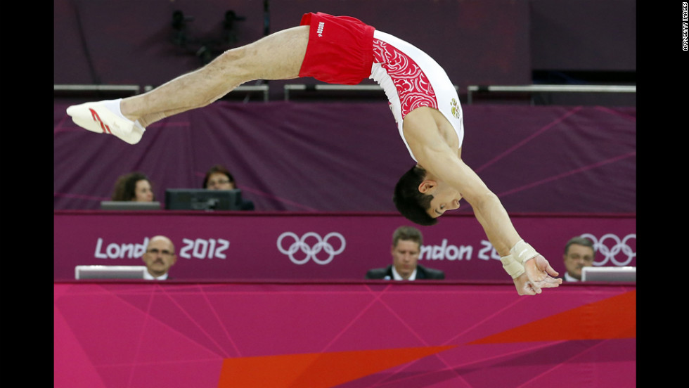 Russian gymnast Emin Garibov competes on the floor during the men's qualification of the artistic gymnastics event.