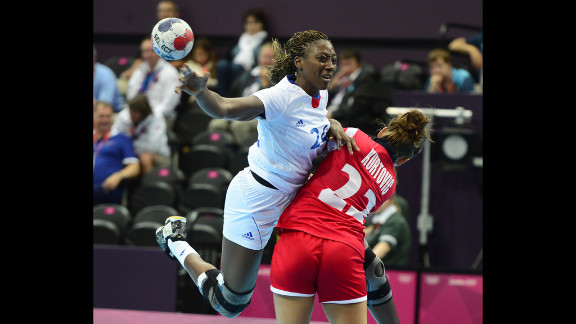 French leftback Mariama Signate. left, vies with Norway's Amanda Kurtovic during a women's preliminary handball match.