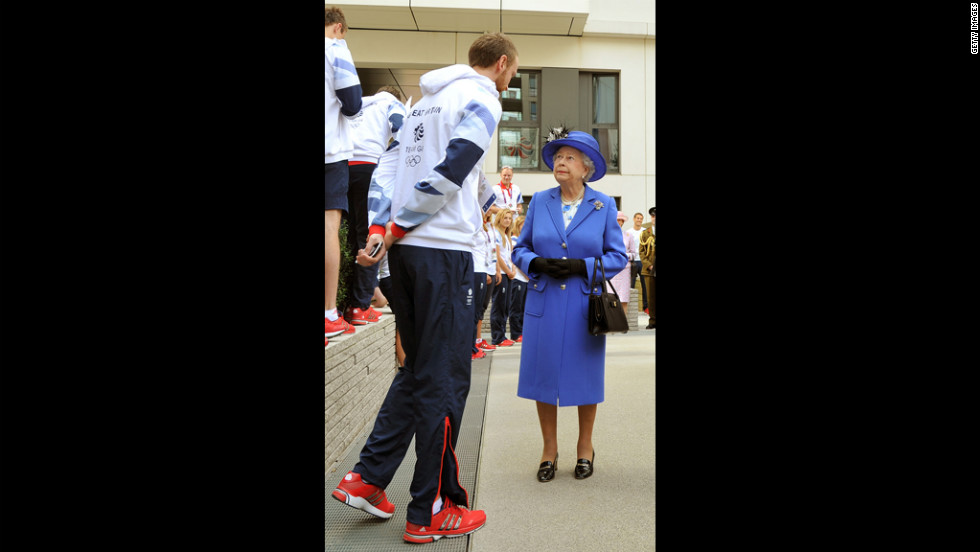 Queen Elizabeth sizes up a rival before her daily one-on-one basketball game.