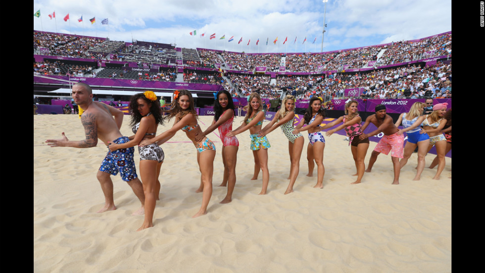 Cheerleaders lead the beach volleyball crowd of 14,000 out of the arena with an impromptu conga line.