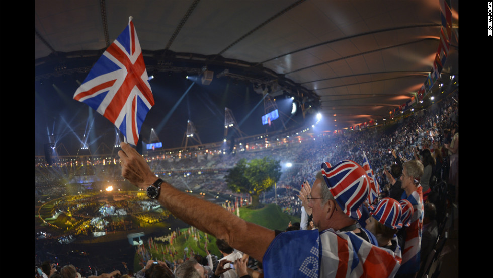 British spectators cheer as they attend the opening ceremony.