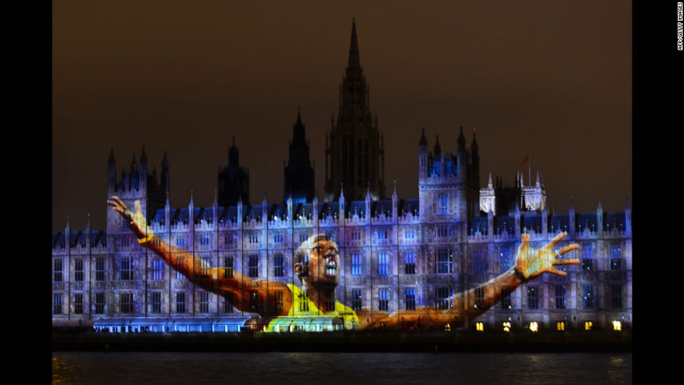 An image of Jamaica's track star Usain Bolt, currently the world's fastest man, is projected on The Houses of Parliament in London.