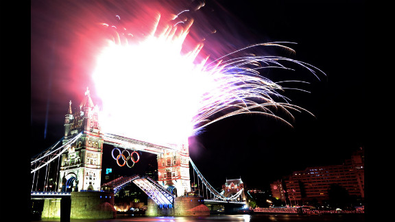Fireworks explode from the top of Tower Bridge.