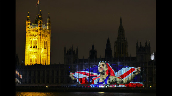 An image of British Olympic champion Jonathan Edwards is projected on the Houses of Parliament .