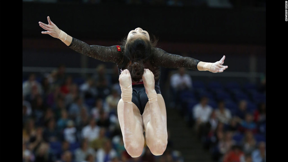 Vietnamese gymnast Thi Ngan Thuong Do performs on the beam during the women's qualification of the artistic gymnastics event.