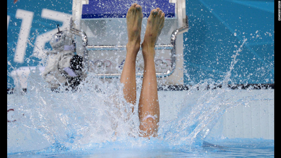 France's Camille Lacourt dives in the water before the men's 100-meter backstroke heat.