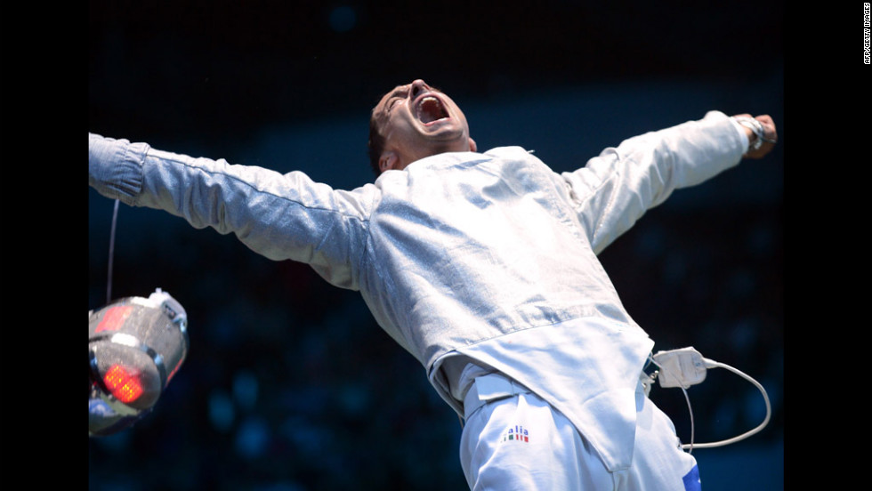 Italy's Diego Occhiuzzi celebrates his victory over Italian teammate Aldo Montano at the end of the men's saber fencing bout.