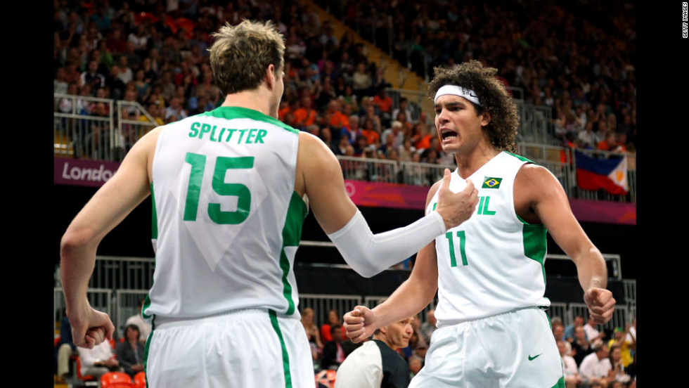 Brazil's Tiago Splitter, left, and teammate Anderson Varejao react after a foul against Australia during the Brazil-Australia men's basketball game.