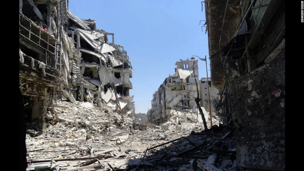 Destruction appears widespread in Homs on Friday, July 27, in a handout photo from the Syrian opposition Shaam News Network.