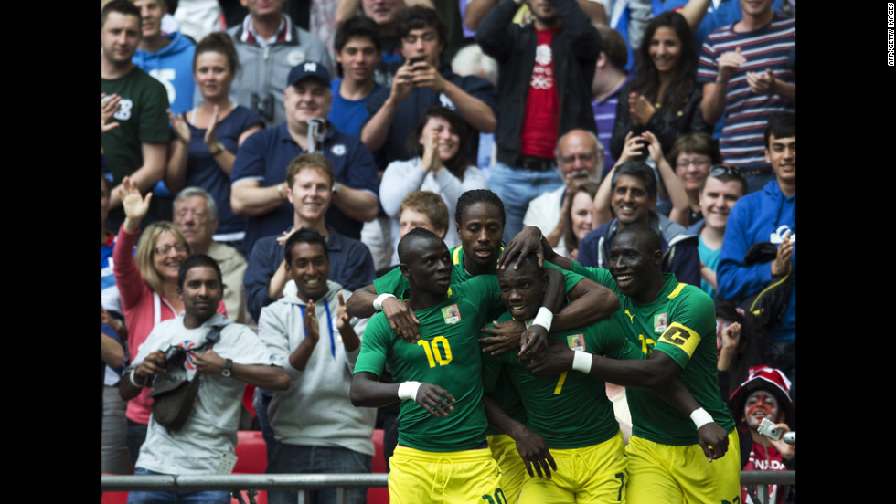 Teammates congratulate Senegal's Moussa Konate after he scores the opening goal against Uruguay in Wembley Stadium.