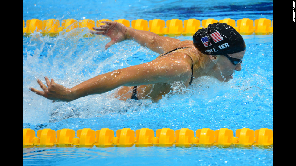 Vollmer set a world record in winning the 100-meter butterfly, becoming the first woman to go under 56 seconds.